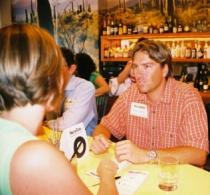 Man and woman talking during a speed date