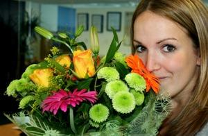 Woman receiving flowers for Valentine's Day