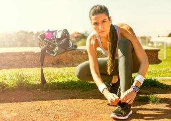 Woman athlete preparing to run