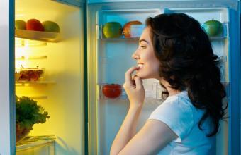 Looking at food in fridge