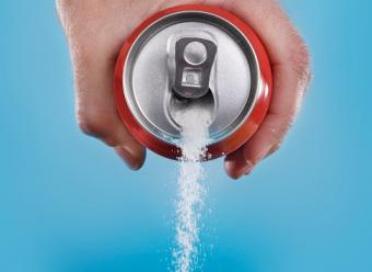 Pouring sugar from soda can