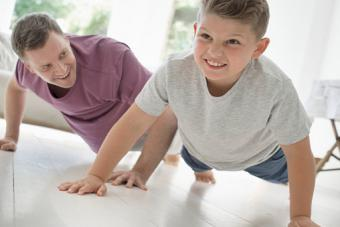 parent and child doing pushups