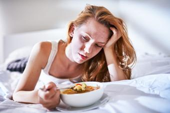 Eating chicken noodle soup when sick