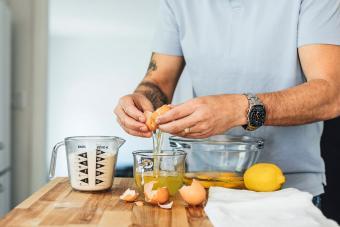 Man cracking an egg into a bowl