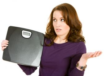 Woman struggling with weight plateau