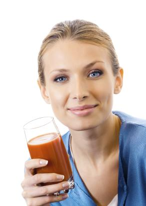 Woman Drinking Tomato Juice