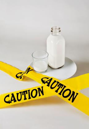 Milk Surrounded by Caution Tape