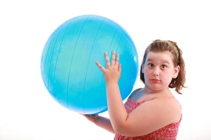Obese Girl Using Exercise Ball