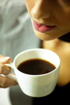 Woman about to sip her coffee