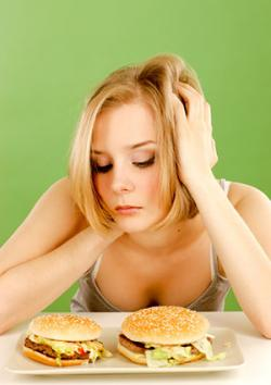 woman with two burgers