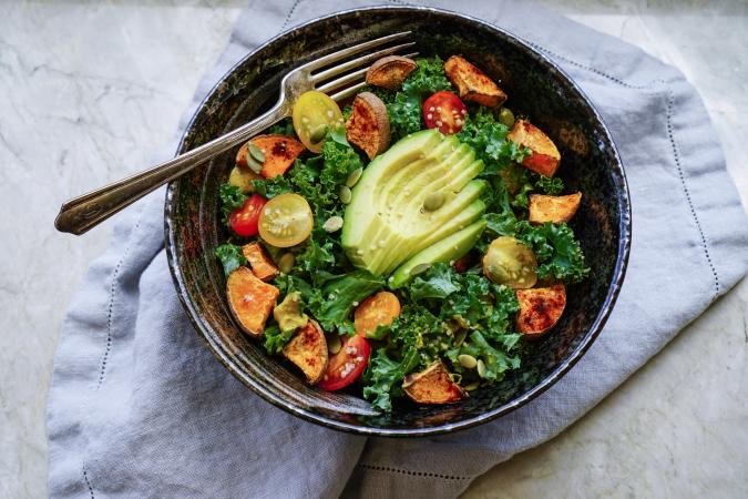 Kale, roasted yams and avocado salad