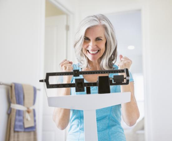 woman excited on scale