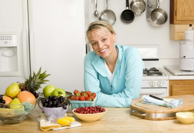 Woman in kitchen with fresh produce