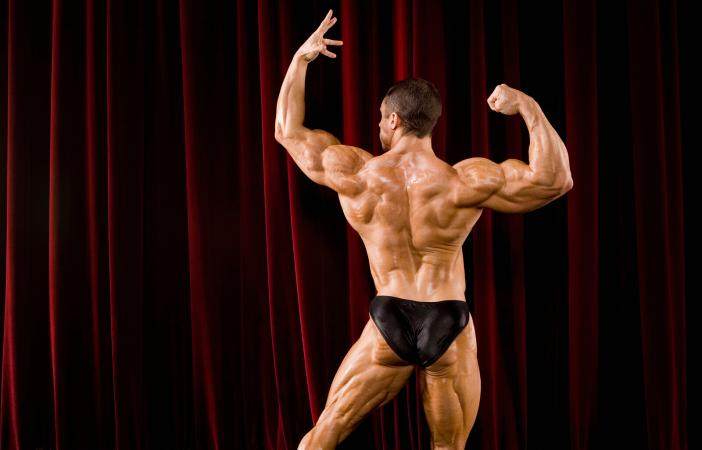 Male body builder flexing on stage