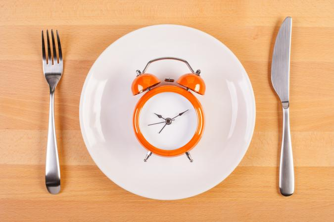Weight loss diet concept with clock