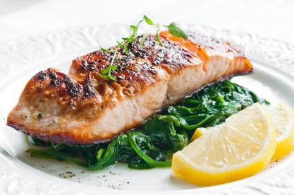 Grilled salmon on bed of spinach