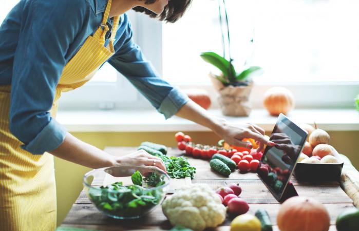 Woman cooking fresh vegetables