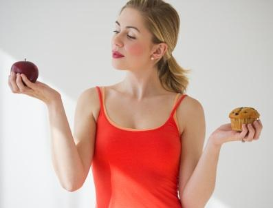 Woman weighing caloric content of foods