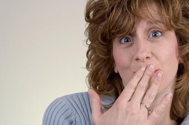 Woman Embarrassed by Flatulence