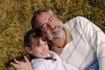 Grandfather and grandchild on grass