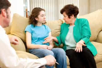 Mother and daughter with a counselor