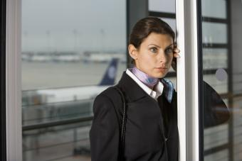 Flight Attendants leaning on a door at the airport