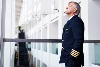 Senior pilot waiting at the airport lobby for flight