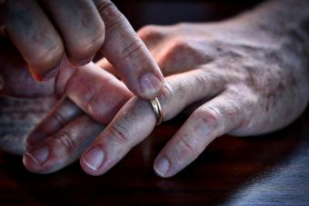 Middle Aged Man Taking His Wedding Ring Off