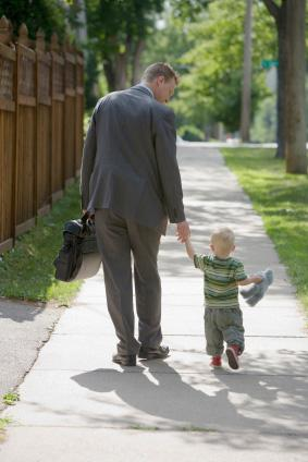 Business man walking with son