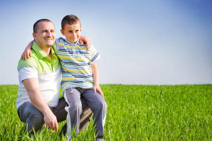 Man and child in wheat field