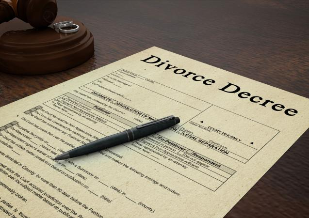 Divorce decree paper with a pen