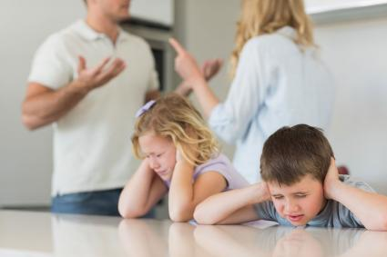 Parents arguing in front of children