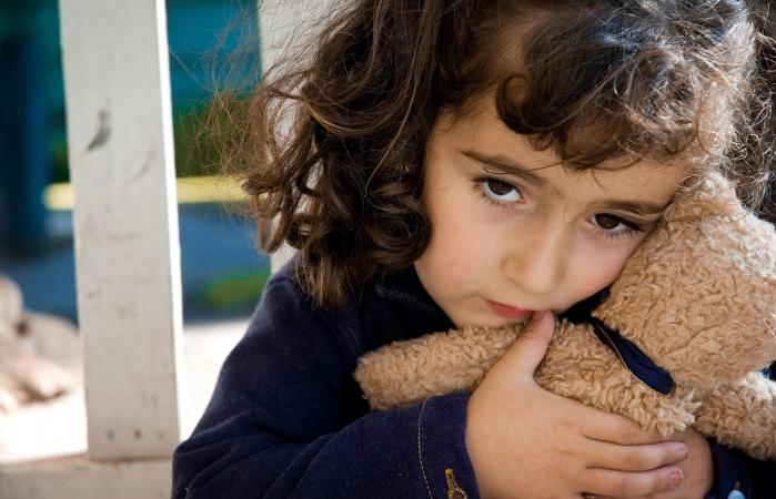 Sad Little Girl holding a Teddy bear