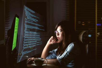 Woman coding at night