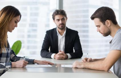 couple getting divorced in lawyers office