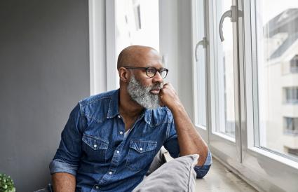 mature man sitting at window