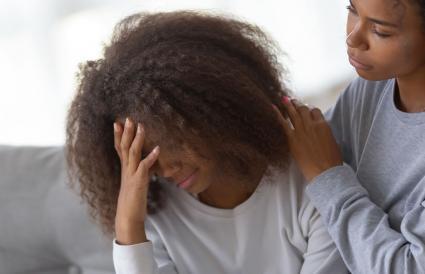 Mom comforting sad teenage daughter