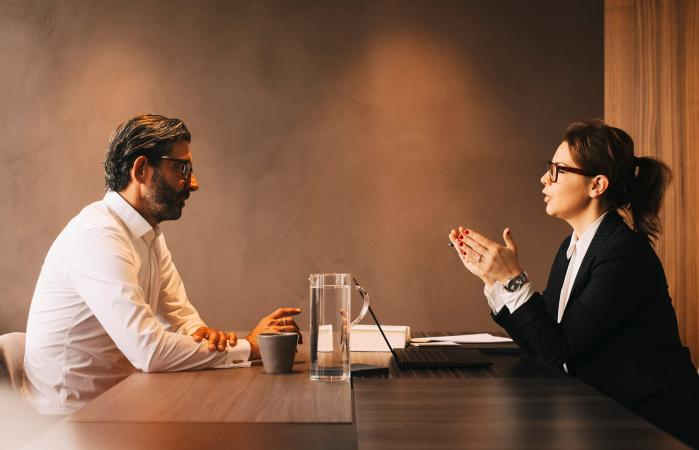 female lawyer talking with client