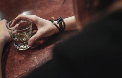 Woman drinking whisky