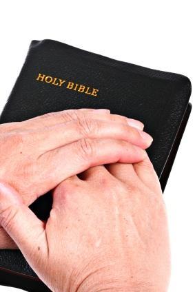 Hands_Over_Bible.jpg