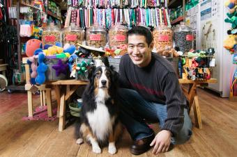 Man with dog in pet shop