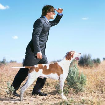 Man standing with English Pointer dog