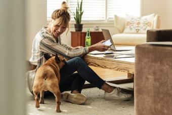 Woman and dog in living room