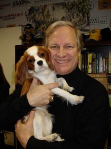 David Frei holding a puppy