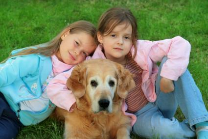 Sisters with their Golden Retriever; Copyright Petr Jilek at Dreamstime.com