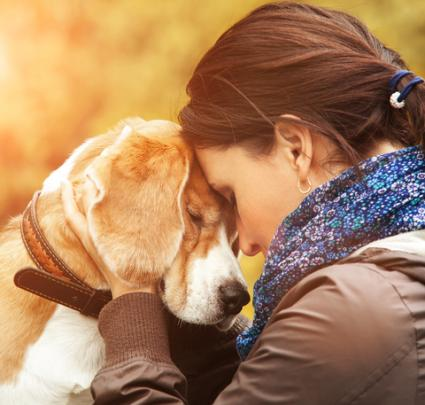 Woman sharing tender moment with dog; © Soloway | Dreamstime.com