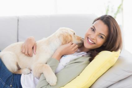 Woman snuggling with puppy; © Wavebreakmedia Ltd | Dreamstime.com