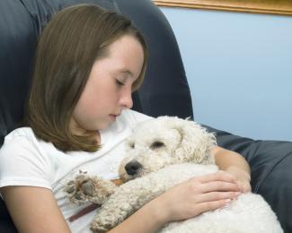 Little girl holding her dog