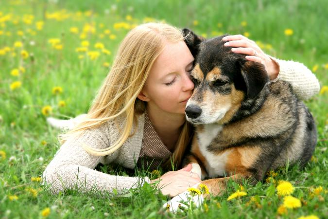 Woman Hugging German Shepherd Dog