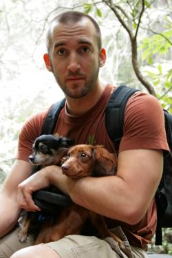 Man holding a Chihuahua and a Dachshund, the two breeds behind Chiweenies